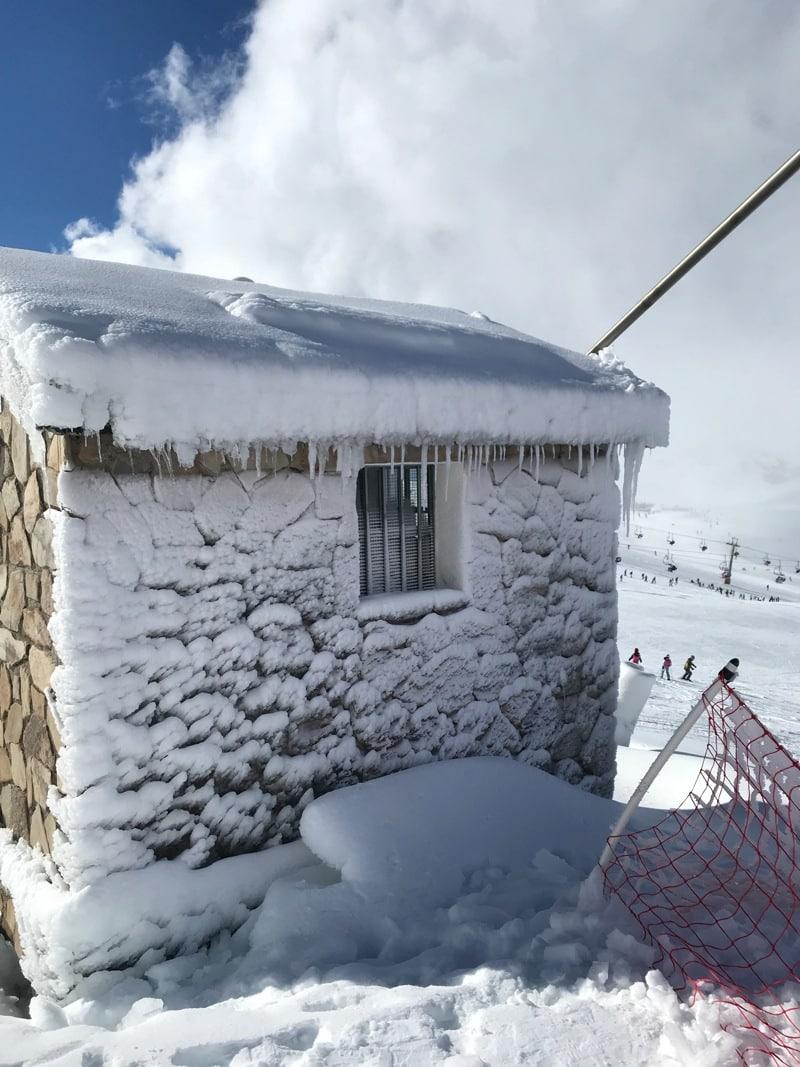 snow blasted building