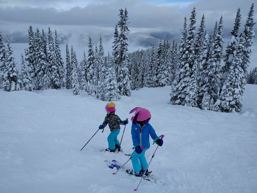 kids skiing with poles