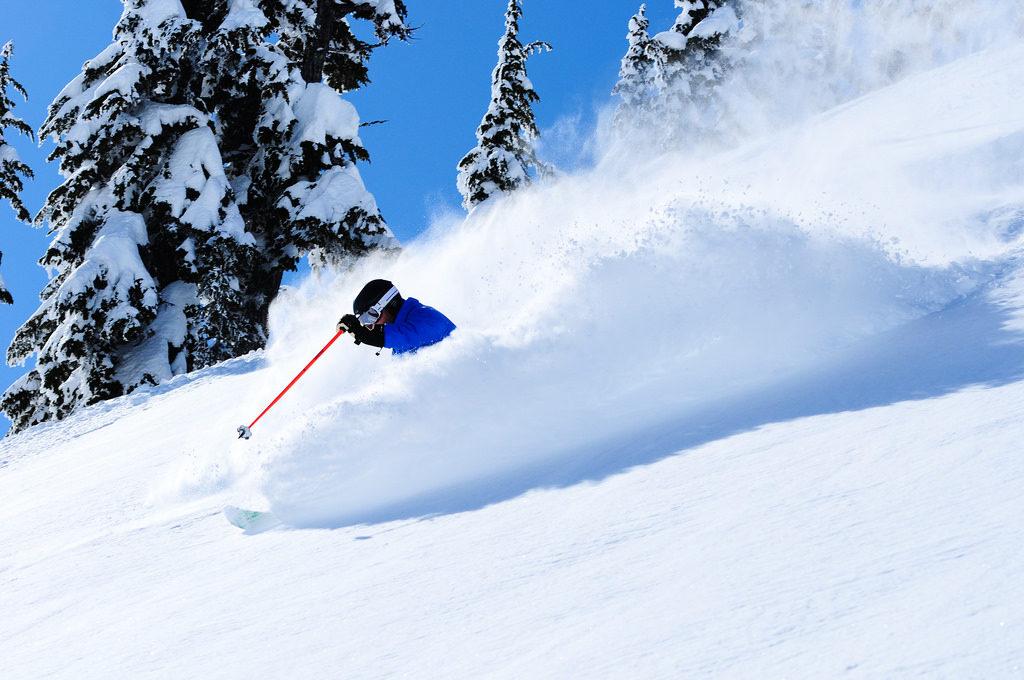 skier spraying powder